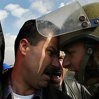 Israeli troops clash with demonstrators during a protest against Israel's controversial separation barrier near the West Bank village of Bilin, Friday, 12 January 2007.Photo by Olivier Fitoussi