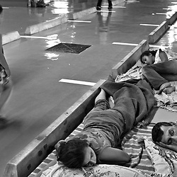 A family sleeps inside the underground parking lot of a mall near the southern suburbs of Beirut, Lebanon, July 21, 2006. The area has is a Hezbollah stronghold. Hezbollah requested that we not reveal the name of the mall. More than an eighth of Lebanon's population have had to flee their homes throughout the country because of constant airstrikes by the Israelis.