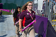 'Games maker' volunteers retrieve arrows during the finals of the paralympic archery at Royal Artillery Barracks, South London
