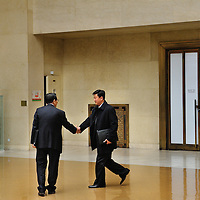 Conference on Disarmament. Year 36, 2015 Session 1, Plenary meeting 1330. Presidency of Mexico.<br /> <br /> A rare event in any context. North and South Korean diplomats shaking hands as they pass each other in the hallway outside the Conference at the end of the plenary.