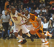 "Tennessee's Melvin Goins (2) takes the ball upcourt against Mississippi guard Zach Graham (32)  and Mississippi guard Nick Williams (20) at the C.M. ""Tad"" Smith Coliseum in Oxford, Miss. on Satursday, January 29, 2011.  (AP Photo/Oxford Eagle, Bruce Newman)"