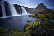 View of Kirkjufell mountain and Kirkjufellfoss waterfall on the northern shore of the Snaefellsnes peninsula, Iceland.