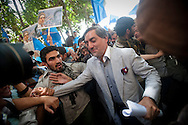 Afghan presidential candidate Abdullah Abdullah makes his way through a crowd of supporters during a rally on the last day of campaigning in  Kabul, Afghanistan on August 17, 2009. Abdullah remains second in the polls for the Afghan elections to be held on August 20th. Photo by Keith Bedford
