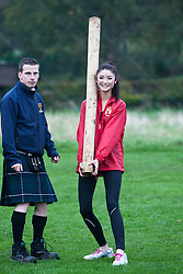 Chu Hay Man Hyman, Miss Hong Kong with Ross McMillan during the caber tossing at the Miss World Highland Games..The Miss World 2011 contestants take part in a highland games in the grounds of Crieff Hydro, Perthshire..MISS WORLD 2011 VISITS SCOTLAND..Pic © Michael Schofield.