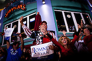 Romney/Ryan supporters cheer at a campaign rally in Daytona Beach, Florida, October 19, 2012.
