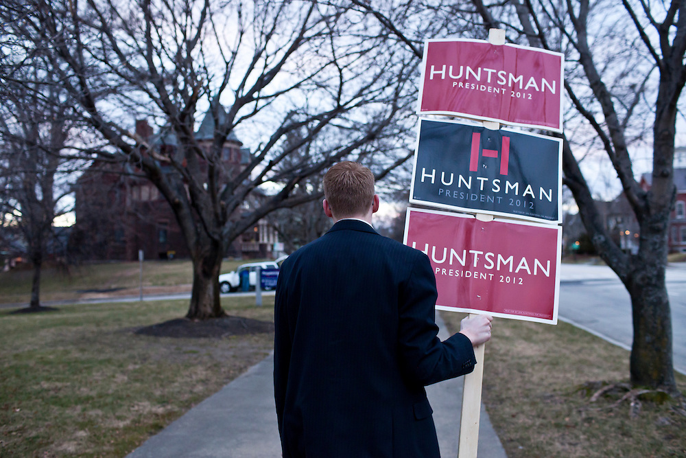Jake Wagner, an intern with the campaign of Republican presidential candidate Jon Huntsman, leads a group of high school students from Mamaroneck High School in Mamaroneck, New York, down Elm Street in support of Huntsman on Sunday, January 8, 2012 in Manchester, NH. The students were on a field trip as part of an AP Government class. Brendan Hoffman for the New York Times