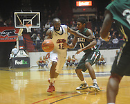 "Ole Miss guard Chris Warren (12)  is defended by Mississippi Valley State's D?Angelo Jackson (11) as he drives past Mississippi Valley State's Cor-J Cox (21) at C.M. ""Tad"" Smith Coliseum in Oxford, Miss. on Monday, December 13, 2010."