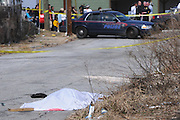 "ATLANTA, GA-February 23, 2011: Police are investigating a shooting that took place off Donald Lee Hollowell Parkway. Police on the scene wouldn't comment, but Carlton McCraty, who lives about 15 feet from where the deceased body lay, said he heard two large booms at around 12:30 this afternoon. ""I just thought it was people working on their cars,"" he said. ""I'm glad it didn't happen when the school was let out 'cause one of the children could have caught a bullet,"" added his wife Melissa McCraty. Three children live in the McCraty household."
