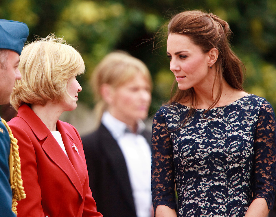 Catherine the Duchess of Cambridge and Laureen Harper, Canadian prime minister Stephen Harper's wife speak following a ceremony at the National War Memorial in Ottawa, Canada,  June 30, 2011, the first stop on their nine-day tour of Canada, kicking off their first official foreign trip as husband and wife.<br /> AFP PHOTO/GEOFF ROBINS