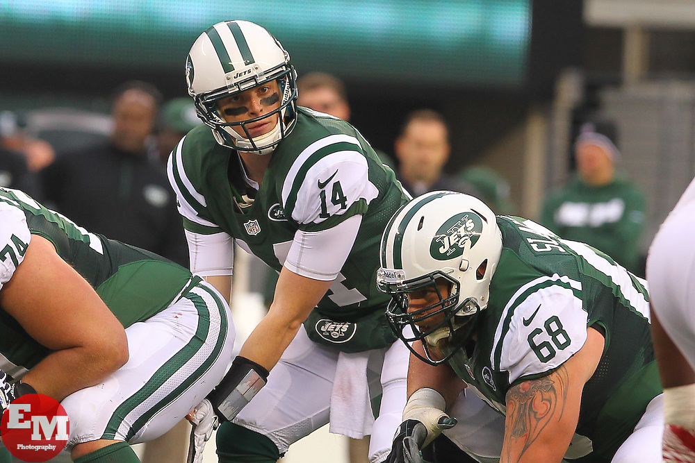 Dec 2, 2012; East Rutherford, NJ, USA; New York Jets quarterback Greg McElroy (14) takes the snap during the second half of their game against the Arizona Cardinals at MetLIfe Stadium.