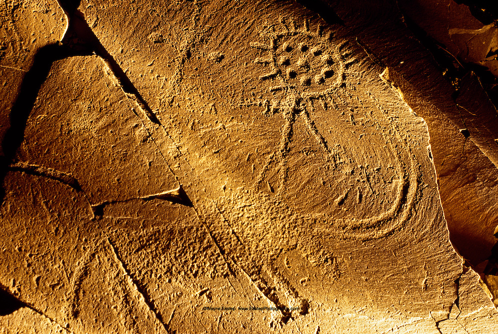 Bronze age petroglyph at tamghali of a sun god riding a bull combines the symbol of fertility and the symbol of the source of life.