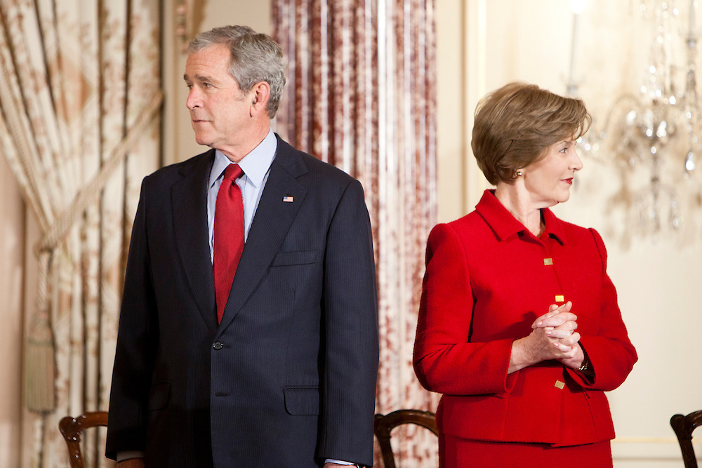 President George W. Bush (L) and wife Laura Bush attend a function at the U.S. State Department on January 15, 2009 in Washington, DC.