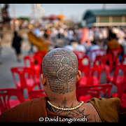 during festivities at the Wat Bangpra Tattoo Festival in  Nakhon Chaisi