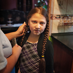 "Bára Kocková, 8, prepares to attend classes at Zakladni Skola, a predominantly Roma elementary school in her neighborhood of Vitkovice in Ostrava, Czech Republic on Feb. 27, 2012. Bára Kocková is a relative of Helena Kocková, one of 18 Roma children who were represented in the D.H. and Others v. Czech Republic case, the first challenge to systemic racial segregation in education to reach the European Court of Human Rights. When this case was first brought in 2000, Roma children in the Czech Republic were 27 times more likely to be placed in ""special schools,"" intended for the mentally disabled, than non-Roma children. In 2007, the Grand Chamber of the European Court of Human Rights ruled that this pattern of segregation violated nondiscrimination protections in the European Convention on Human Rights. Despite this landmark decision, little change has occurred: the ""special schools"" have been renamed but follow the same substandard curriculum and Roma continue to be assigned to these schools in disproportionate numbers. The process of integration has barely begun."