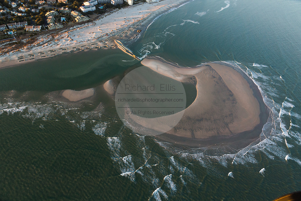 Aerial view of a manmade island emerging offshore during a beach restoration project to halt erosion in Charleston, SC