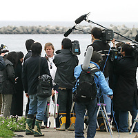 Tim Blackman ( father of murdered UK national Lucy), (facing camera) talks to the press after paying his respects to Lucy by visiting the cave, and drinking champagne in her memory, on the beach where her dismembered body was found, Aburatsubo beach, near Tokyo, Japan on Monday, April 23rd 2007.  The verdict will be announced in the trial of Joji Obara for Lucy Blackman's murder (and rapes of other women) on Tuesday April 24th 2007,