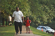 Preston Shaw (left) walks Dytarrius Jones into school on the first day of school at Bramlett Elementary in Oxford, Miss. on Thursday, August 4, 2011.