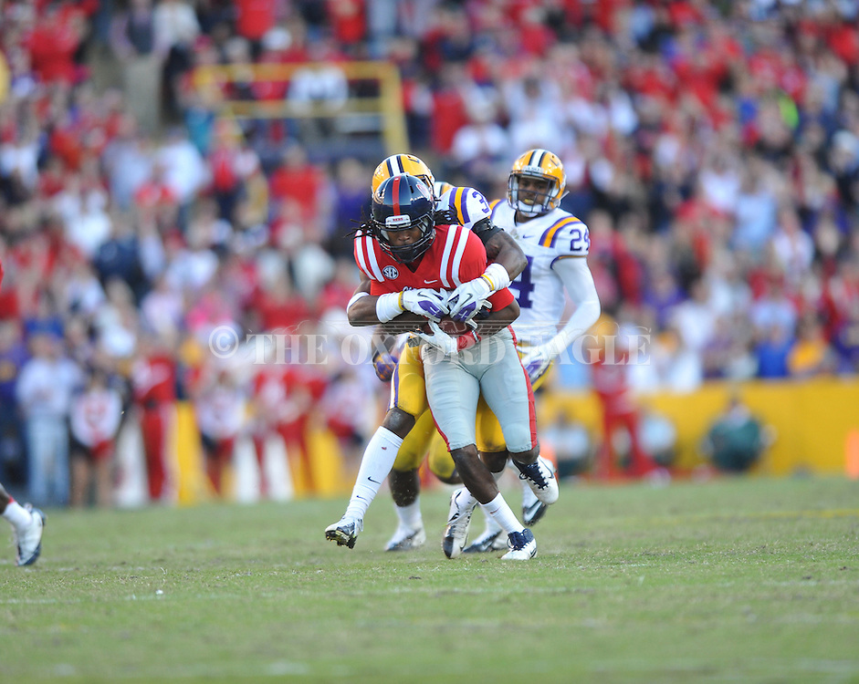 Ole Miss wide receiver Ja-Mes Logan (85) vs. LSU safety Micah Eugene (34) at Tiger Stadium in Baton Rouge, La. on Saturday, November 17, 2012. LSU won 41-35.....