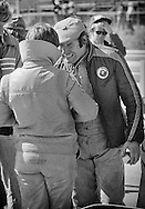 Italian Formula One driver Vittorio Brambilla, offers advice to fellow Italian Formula One driver Lella Lombardi, here in 1975, at the United States Grand Prix, driving for the Frank Williams team. Brambilla was coming off a surprise victory at the Austrian Grand Prix earlier that season, and took Lombardi under his wing. <br /> <br /> Lombardi competed in 17 total Grand Prix events and driving the Lavazza March 751, became the first woman Formula One driver to have a top six points-awarded finish in a World Championship race, during the rain-shortened 1975 Spanish Grand Prix. Brambilla had finished one position ahead of Lombardi.<br /> <br /> Brambilla graduated from Formula 2 to Formula One in 1975, driving for the Beta Tools-March F1 team. The March 751 was very unreliable throughout the season until his Austrian Grand Prix breakthrough. <br /> <br /> Although competitive until his retirement, Brambilla was injured during the 1978 Italian Grand Prix accident involving Ronnie Peterson, he never again had an opportunity for victory.