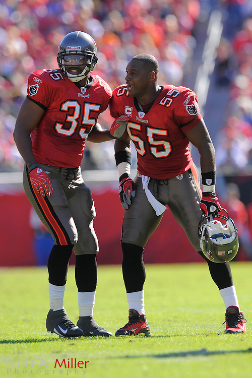 Nov. 16, 2008; Tampa, FL, USA; Tampa Bay Buccaneers running back B.J. Askew (35) and linebacker Derrick Brooks (55) during the Bucs game against the Minnesota Vikings at Raymond James Stadium. The Bucs won 19-13. ...©2008 Scott A. Miller
