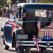 A boy has a blast hanging out of a 1929 Model A Ford in the July 4th Independence Day parade in Port Angeles.