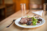 Hamilton's on the Square's lamb chops featuring pearl onions, roasted turnips, spicy greens, minted yogurt and rosemary oil, Monday, November 2, 2015.