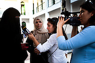 A young TV reporter interviews a women in Hijab on election day. Many women in Tunisia fear that an Islamic governemnt will force them to wear veils.