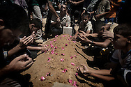 Gaza Strip, Deir Balah: Mourners pray on the grave of Mahmud Jaarouni 55 y.o. killed by an overnight Israeli airstrike in Deir Balah on August 10, 2012. ALESSIO ROMENZI