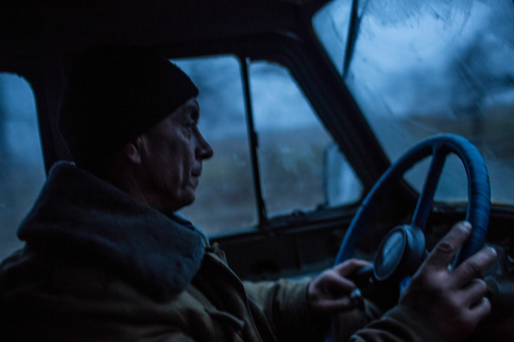 PIKSY, UKRAINE - NOVEMBER 19, 2014: A member of the Dnipro-1 brigade, a pro-Ukraine militia, drives toward the village of Pervomaiske from Pisky, Ukraine. The village of Pisky is the scene of much of the front-line fighting over the Donetsk airport. CREDIT: Brendan Hoffman for The New York Times