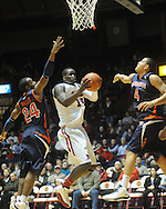 Ole Miss'  Eniel Polynice (14) vs. Auburn's Tay Waller (24) and Lucas Hargrove (4) in Oxford, Miss. on Wednesday, February 24, 2010. Ole Miss won 85-75, giving coach Andy Kennedy his 100th win as a head coach.