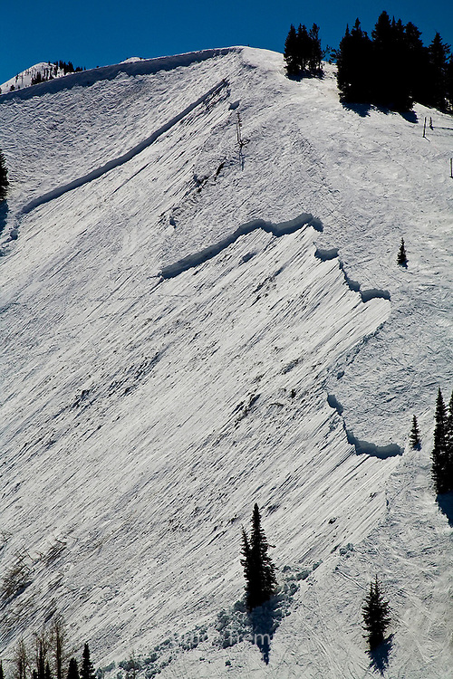 An avalanche purposely triggered by ski patrollers using explosives at Park City Mountain Resort in Utah.  The fracture was about two hundred yards wide and 2-3 feet deep. This was a wet slab avalanche and the instability was caused by rapid and prolonged warming in spring.