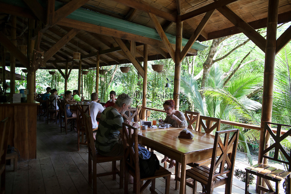 Visitors and habitants of Finca Bellavista having breakfast together at the Base Camp of Finca, at the bottom of the property