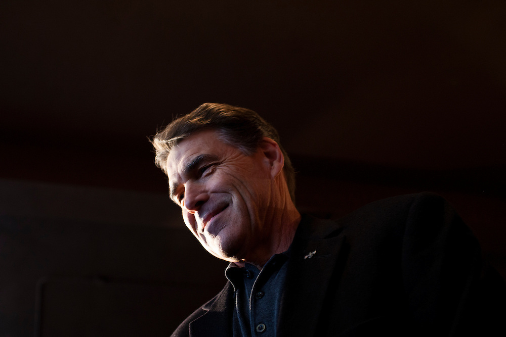 Republican presidential candidate Rick Perry greets supporters at Kuhly's Bar & Grill on Thursday, December 22, 2011 in Ottumwa, IA.