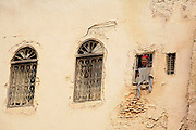 An elderly woman peers out of a window in Fes, Morocco on Monday morning, May 28, 2007. Many of the old homes in Fes have only small windows so nobody could see in; other newer buildings have large patios and many windows. (PHOTO BY TIMOTHY D. BURDICK)