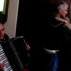 An accordion player performs for two people (who do not know each other) in a pub in Tallinn, Estonia in Sept. 2009. The young democracy joined the European Union in 2004 and since has been working on getting the euro as its national currency. Estonia has one of the highest per capita incomes in central europe.