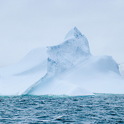 Antarctic glaciers compress years of snowfall into banded ice layers, which calve into the Southern Ocean as icebergs with odd shapes and patterns.