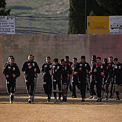 Members of the Bnei Sakhnin soccer team meet for practice, Sakhnin, Isreal, Jan. 30, 2006.  The field is just outside of the hometown of Israeli soccer star Abbas Suan. The team has a mixture of Israeli-Arab, Israeli, and foreign players.  Suan, Israeli-Arab, Suan still faces criticism and racism resulting from the unsettled conflict between the Israelis and Palestinians.