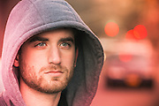young man with a beard wearing a hoody in New York City