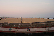 Santhome beach front looking towards Marina beach. Santhome Beach and adjoining Marina Beach in Chennai, India were hit hard by the 2004 Tsunami. Fishermen and their families were the main victims living in their lightweight huts on the long and flat beaches of the area. All structures within 300 metres of the sea have now been banned and any left standing after the Tsunami were demolished. The fishermen and their families have now been relocated to government blocks of flats which has become a Santhome slum for fishermen and their families.