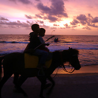 COLOMBO, 4 OCTOBER , 2005: a child rides a pony along the beach in Colombo, Sri Lanka. Locals were afraid to go down to the beaches for weeks after the earthquake on December 26, 2004, measuring 9 on the Richter scale triggered a series of tidal waves which caused devastation when they struck dry land. In total 12 countries were affected by the tsunami, with a combined death toll of over 280,000.