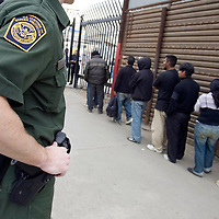 Undocumented immigrants are returned to Mexico after being detained in San Diego, California on January 20th, 2009. Forty seven migrants were apprehended during the morning hours of inauguration day and deported to Mexico with only their belongings in paper bags.