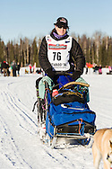Musher Karin Hendrickson competing in the 44th Iditarod Trail Sled Dog Race on Long Lake after leaving the restart on Willow Lake in Southcentral Alaska.  Afternoon. Winter.