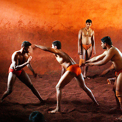 "Traditional Indian wrestling-Kushti : Indian men practice the three thousand year old sport known as ""Kushti"", a form of wrestling, in its traditional form at the fight club Shahupuri on March 22, 2005 in Kolhapur, India.  In this south-eastern Indian city Kushti has a long tradition. It used to be supported by local kings, called maharajas, and is financed by the government. But its days are coming to an end. Last year, the Indian Fighters Federation stunned thousands of fighters when it announced prohibition of fighting on red soil and ordered fight clubs to buy mattresses for their arenas. Ending the traditional red clay wrestling was an idea sprouted from the aspiration to achieve more Olympic medals since the last and only medal India brought home in wrestling was a bronze in 1952. So far no one here in Kolhapur is buying the mattresses and instead they continue the rigorous schedule of waking up at 3:30am six times a week and practicing more than 6 hours every day. They live together in one small room above the arena and their only belongings are a blanket, a few items of clothes and some books about the art of Kushti. They have been compared to holy men because of their celibacy and dedication and they practice exercises like standing on one's head for lengths of time to expel ""filthy"" thoughts."