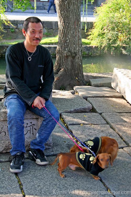 Asia, Japan, Nara. Manly dogs.