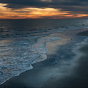 Dusk and sunset, sand, sea and clouds.