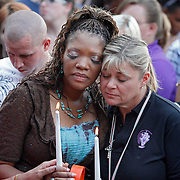 SHOT 7/22/12 7:58:03 PM - Titia Stillwell (left) and Lori Meade, both of Aurora, Colo. hug and pray as shooting victims, their families and community members gathered to remember those lost in the movie theater shootings during a prayer vigil at the Aurora Municipal Center in Aurora, Colo. on Sunday evening July 22, 2012. The two women go to church together at the Potter's House Church of Denver. James Eagan Holmes will face charges in the shootings that occurred on Friday July 20, 2012 in which twelve people were killed and another 58 were injured. (Photo by Marc Piscotty / © 2012)