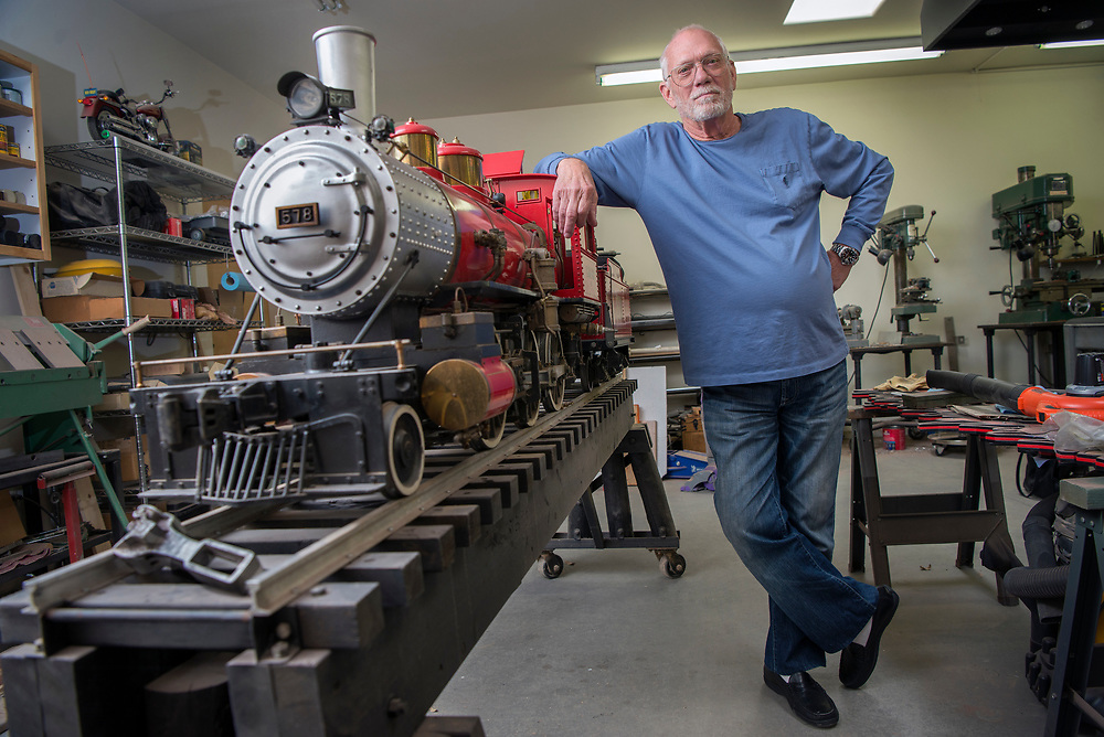 em042117a/living/Jack Harris poses with his fully working 500 lb. model of a F4 Walbash steam engine. The train is in his workshop at him home in Santa Fe, Friday April 21, 2017. (Eddie Moore/Albuquerque Journal