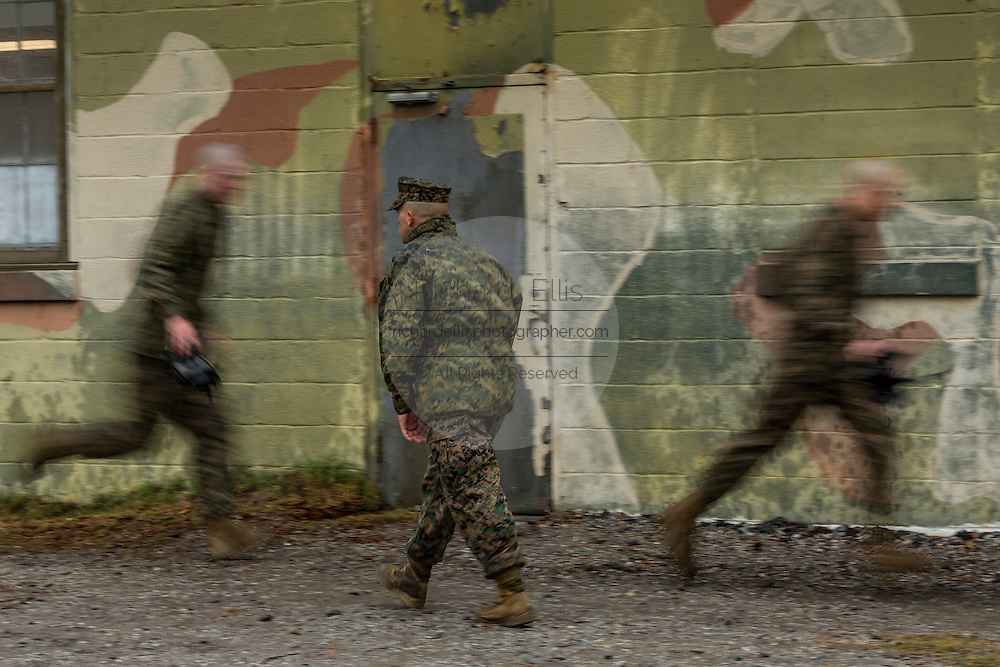 US Marines runs at the command of a drill instructor during bootcamp January 13, 2014 in Parris Island, SC.