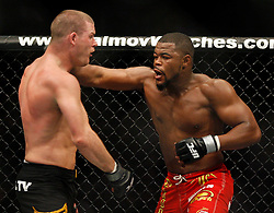November 17, 2007; Newark, NJ, USA;  Michael Bisping (black trunks) and Rashad Evans (red trunks) battle during their bout at UFC 78: Validation at the Prudential Center in Newark, NJ.  Evans won via split decision.