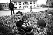 """Boys contest their physical power in the streets of Shushi. This image is part of the photoproject """"The Twentieth Spring"""", a portrait of caucasian town Shushi 20 years after its so called """"Liberation"""" by armenian fighters. In its more than two centuries old history Shushi was ruled by different powers like armeniens, persians, russian or aseris. In 1991 a fierce battle for Karabakhs independence from Azerbaijan began. During the breakdown of Sowjet Union armenians didn´t want to stay within the Republic of Azerbaijan anymore. 1992 armenians manage to takeover """"ancient armenian Shushi"""" and pushed out remained aseris forces which had operate a rocket base there. Since then Shushi became an """"armenian town"""" again. Today, 20 yeras after statement of Karabakhs independence Shushi tries to find it´s opportunities for it´s future. The less populated town is still affected by devastation and ruins by it´s violent history. Life is mostly a daily struggle for the inhabitants to get expenses covered, caused by a lack of jobs and almost no perspective for a sustainable economic development. Shushi depends on donations by diaspora armenians. On the other hand those donations have made it possible to rebuild a cultural centre, recover new asphalt roads and other infrastructure. 20 years after Shushis fall into armenian hands Babies get born and people won´t never be under aseris rule again. The bloody early 1990´s civil war has moved into the trenches of the frontline 20 kilometer away from Shushi where it stuck since 1994. The karabakh conflict is still not solved and could turn to an open war every day. Nonetheless life goes on on the south caucasian rocky tip above mountainious region of Karabakh where Shushi enthrones ever since centuries."""